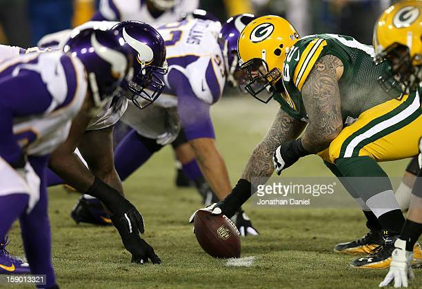 Guard Evan DietrichSmith of the Green Bay Packers waits to snap the football against the Minnesota Vikings in the first quarter during the NFC Wild...