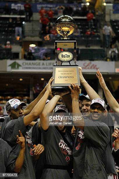 Guard Evan Turner Mark Titus and David Lighty of the Ohio State Buckeyes lift the Big Ten tournament championship trophy after winning the Big Ten...