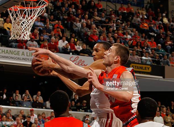 Guard Evan Turner of the Ohio State Buckeyes grabs a rebound against the Illinois Fighting Illini in the semifinals of the Big Ten Men's Basketball...