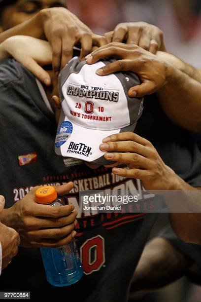 Guard Evan Turner of the Ohio State Buckeyes is congratulated by his teammates after being named the Big Ten Men's Basketball Tournament MVP...