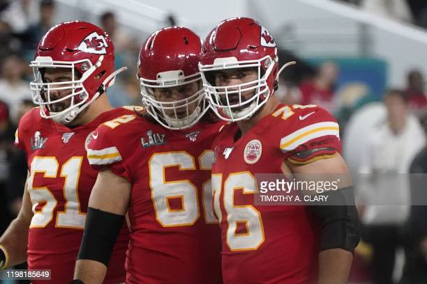 Guard for the Kansas City Chiefs Laurent DuvernayTardif and Center for the Kansas City Chiefs Austin Reiter look on during Super Bowl LIV between the...
