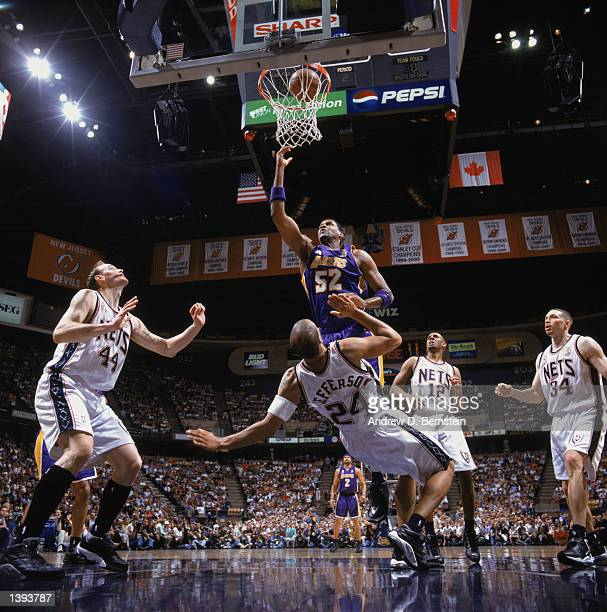 Guard Forward Samaki Walker of the Los Angeles Lakers bowls over forward Richard Jefferson of the New Jersey Nets under the basket during Game Four...