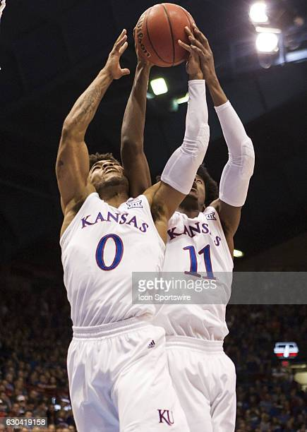 Guard Frank Mason III and Gurard Josh Jackson go up for the rebound during the game between the UNC Asheville Bulldogs and the Kansas Jayhawks on...