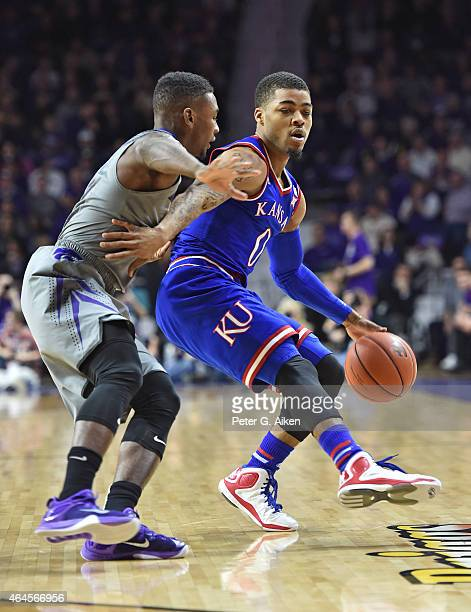 Guard Frank Mason III of the Kansas Jayhawks drives with the ball against guard Nigel Johnson of the Kansas State Wildcats during the first half on...