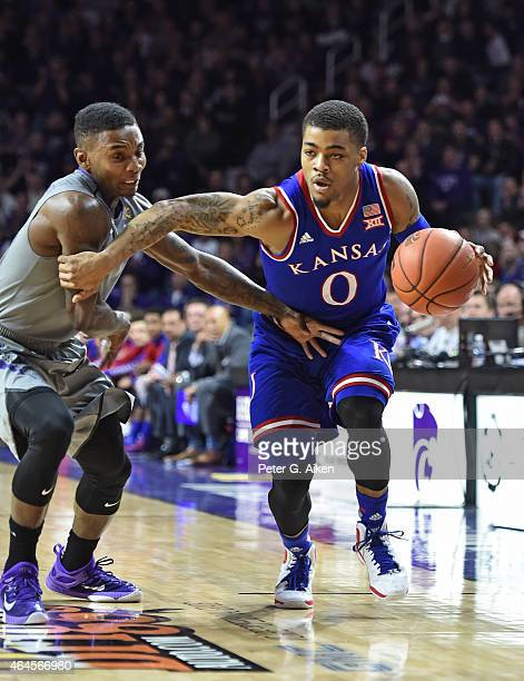 Guard Frank Mason III of the Kansas Jayhawks drives with the ball against guard Jevon Thomas of the Kansas State Wildcats during the first half on...