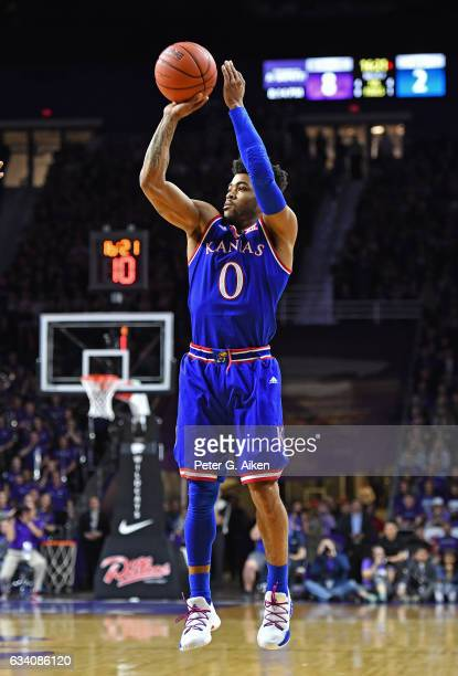 Guard Frank Mason III of the Kansas Jayhawks hits a three-point shot against the Kansas State Wildcats during the first half on February 6, 2017 at...