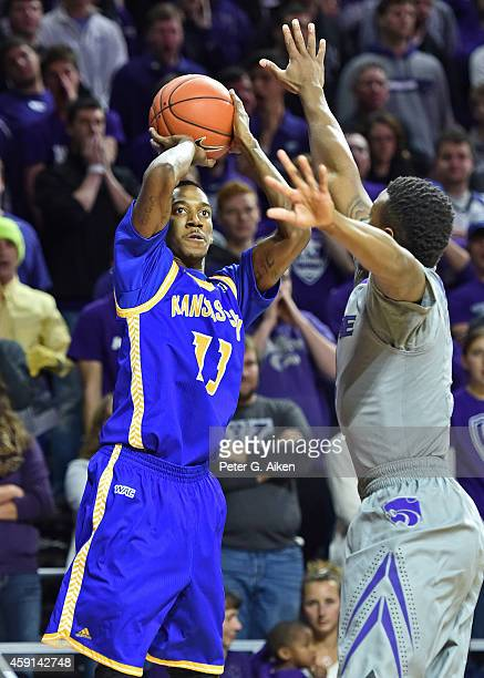 Guard Frank Williams Jr #13 of the UMKC Roos hits a threepoint shot against the Kansas State Wildcats during the first half on November 17 2014 at...