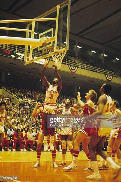 Guard Fred Carter of the Baltimore Bullets shoots a layup teammates Wes Unseld Gus Johnson Kevin Loughery and John Tresvant and forward Dennis Awtrey...