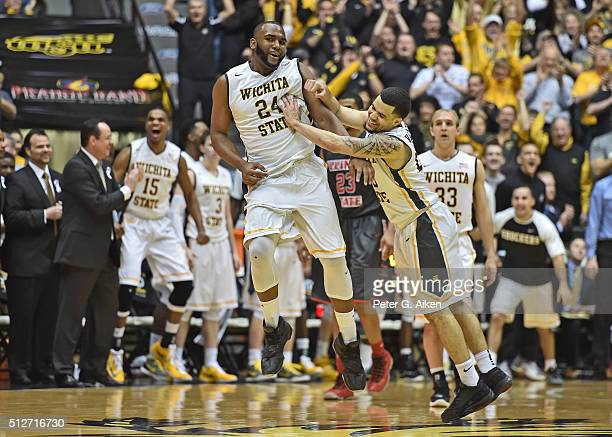 Guard Fred VanVleet of the Wichita State Shockers celebrates after teammate Shaquille Morris scored against the Illinois State Redbirds during the...