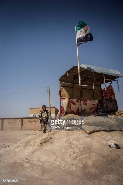 A guard from FSA unit Quwat Al Nukhba stand guard of their training camp Over 1500 to 3000 young Arab men have gone through 2 weeks of intensive...