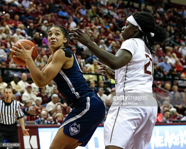 Guard Gabby Williams of the Connecticut Huskies shoots over forward Shakayla Thomas of the Florida State Seminoles at the Donald L Tucker Center on...