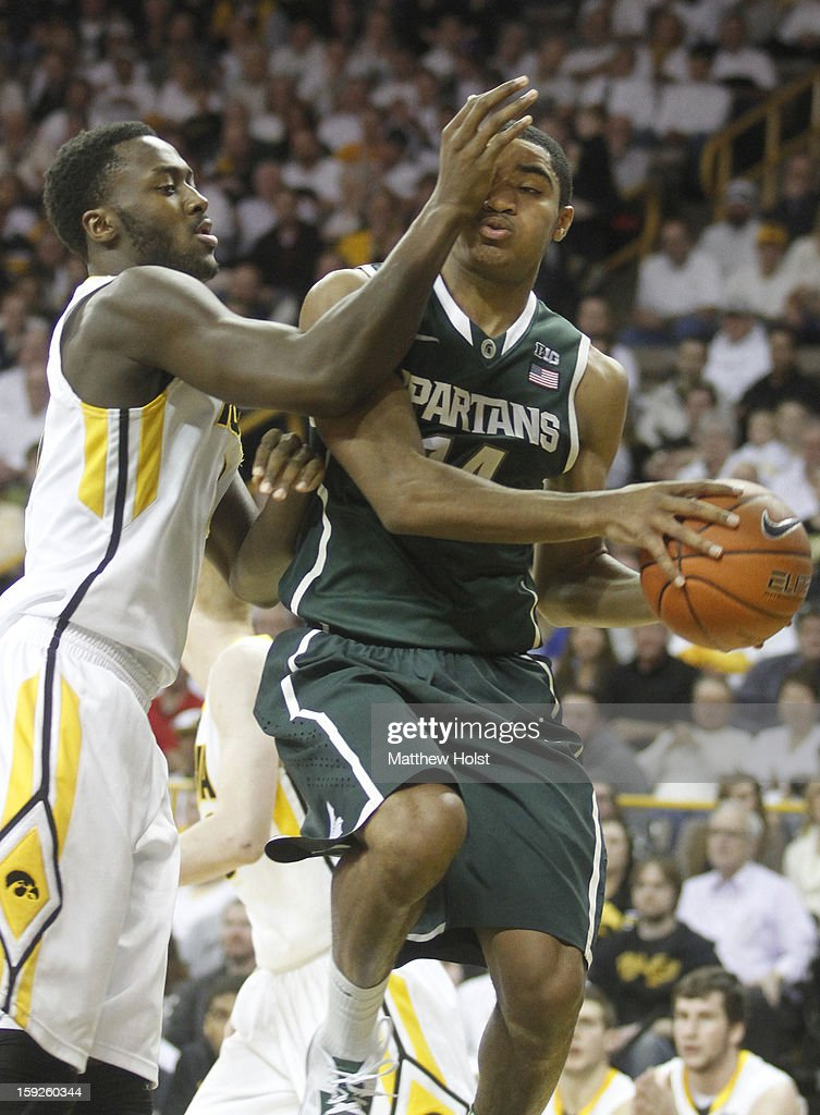 Guard Gary Harris #14 of the Michigan State Spartans drives to the basket during the first half against center Gabriel Olaseni #0 of the Iowa Hawkeyes on January 10, 2013 at Carver-Hawkeye Arena in Iowa City, Iowa.