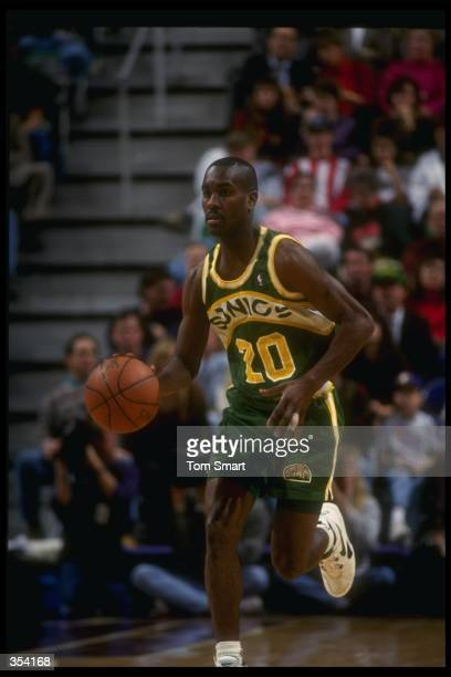 Guard Gary Payton of the Seattle SuperSonics moves the ball during a game against the Utah Jazz at the Delta Center in Salt Lake City Utah Mandatory...
