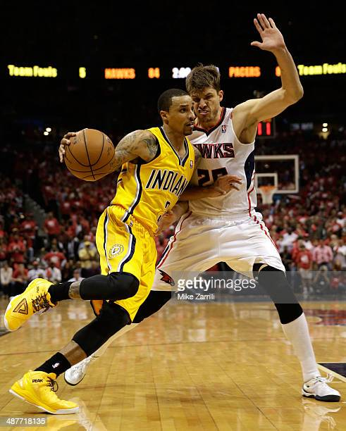 Guard George Hill of the Indiana Pacers drives guard Kyle Korver of the Atlanta Hawks in Game 6 of the Eastern Conference Quarterfinals during the...