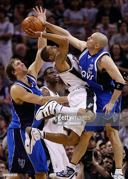 Guard George Hill of the San Antonio Spurs takes a shot against Jason Kidd and Dirk Nowitzki of the Dallas Mavericks in Game Four of the Western...