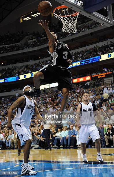 Guard George Hill of the San Antonio Spurs takes a shot against Antoine Wright of the Dallas Mavericks in Game Three of the Western Conference...