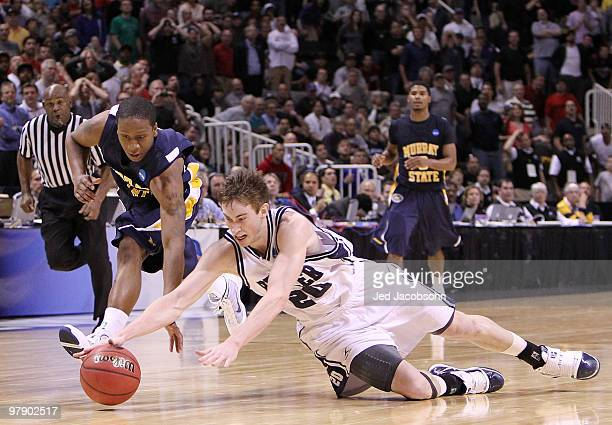 Guard Gordon Hayward of the Butler Bulldogs dives after the ball with guard Isaiah Canaan of the Murray State Racers as time expires in the second...