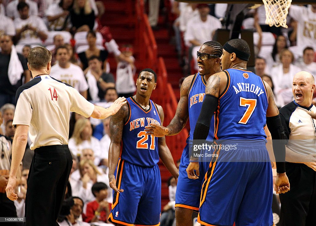Guard Iman Shumpert #21, Amar'e Stoudemire #1 (C) and carmelo Anthony #7 of the New York Knicks argue with the referee against the Miami Heat in Game One of the Eastern Conference Quarterfinals in the 2012 NBA Playoffs on April 28, 2012 at the American Airines Arena in Miami, Florida. The Heat defeated the Knicks 100-67.