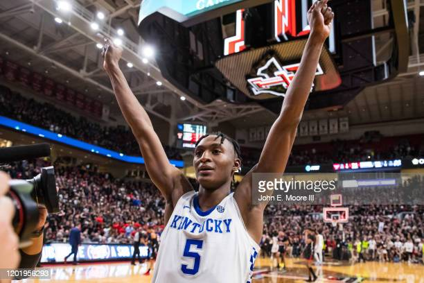 Guard Immanuel Quickley of the Kentucky Wildcats gestures to the crowd after the college basketball game against the Texas Tech Red Raiders on...