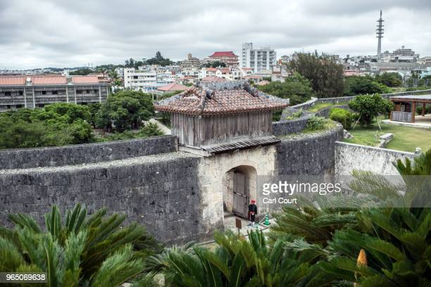 A guard in traditional Okinawan dress mans a doorway at Shuri Castle on June 1 2018 in Naha Japan Like the rest of Japan the southern island of...