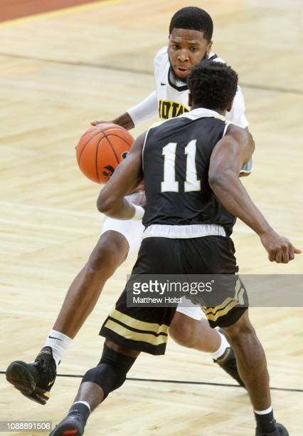 Guard Isaiah Moss of the Iowa Hawkeyes drives down the court in the first half against guard Adam Grant of the Bryant Bulldogs on December 29 2018 at...