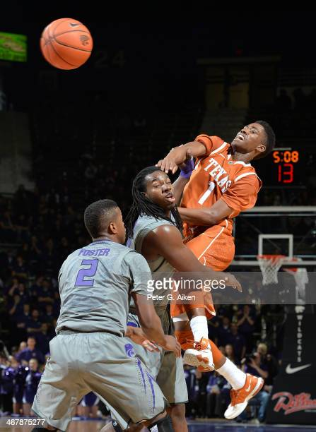 Guard Isaiah Taylor of the Texas Longhorns makes a pass against forward D.J. Johnson of the Kansas State Wildcats during the first half on February...