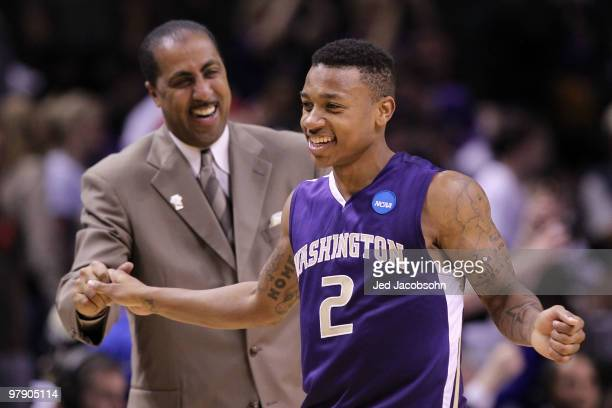 Guard Isaiah Thomas and head coach Lorenzo Romar of the Washington Huskies celebrate after their 82-64 win over the New Mexico Lobos in the second...