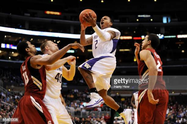 Guard Isaiah Thomas of the Washington Huskies takes a shot during their 85-73 win over the Stanford Cardinal in the Pacific Life Pac-10 Men's...