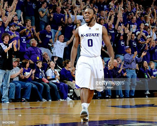 Guard Jacob Pullen of the Kansas State Wildcats reacts after hitting a threepoint shot late in the first half against the Washington State Cougars on...