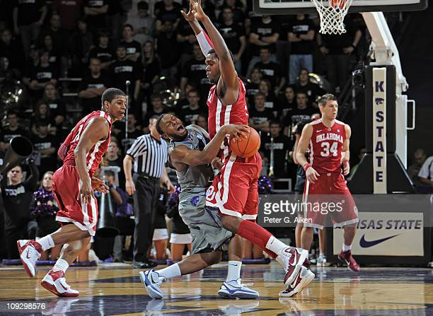 Guard Jacob Pullen of the Kansas State Wildcats runs into forward Andrew Fitzgerald of the Oklahoma Sooners during the first half on February 19,...