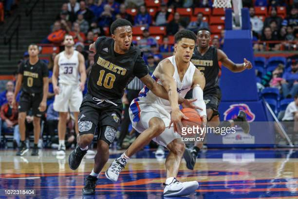Guard Jacoby Ross of the Alabama State Hornets and guard Malek Harwell of the Boise State Broncos scramble for a loose ball during second half action...