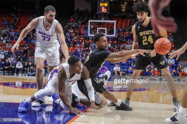 Guard Jacoby Ross of the Alabama State Hornets finds an open passing lane while surrounded by the Boise State Broncos defense during second half...