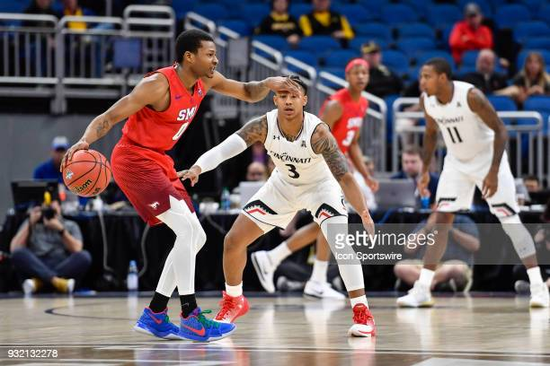 SMU guard Jahmal McMurray is guarded by Cincinnati guard Justin Jenifer during the first half of the AAC Men's Basketball Conference Tournament game...