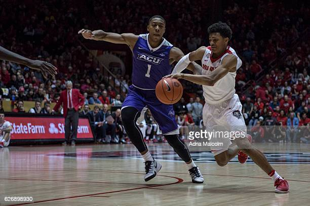 Guard Jalen Harris of the New Mexico Lobos dribbles past guard Jaren Lewis of the Abilene Christian Wildcats at The Pit on November 30 2016 in...