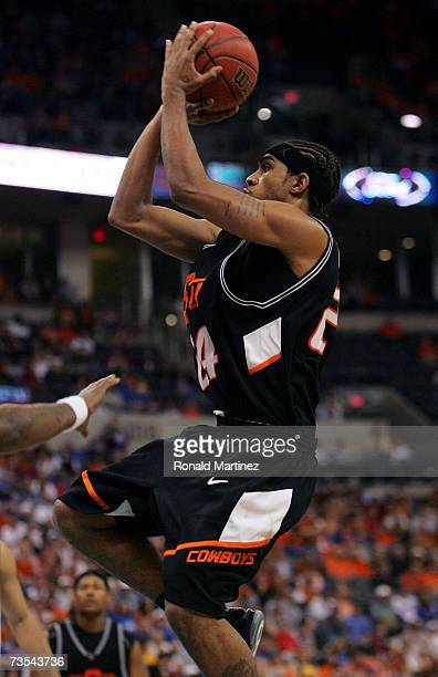 Guard JamesOn Curry of the Oklahoma State Cowboys takes a shot against the Texas Longhorns during the semifinals of the Phillips 66 Big 12 Men's...