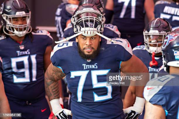 Guard Jamil Douglas of the Tennessee Titans prepares to run out before their AFC Wild Card Playoff game against the Baltimore Ravens at Nissan...