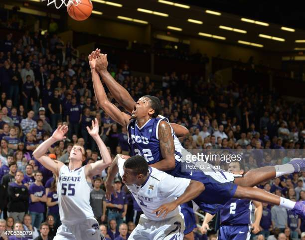 Guard Jarvis Ray of the TCU Horned Frogs leaps over guard Marcus Foster of the Kansas State Wildcats for a loose ball during the first half on...