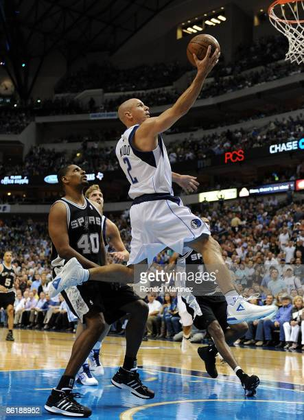 Guard Jason Kidd of the Dallas Mavericks takes a shota against Kurt Thomas of the San Antonio Spurs in Game Three of the Western Conference...
