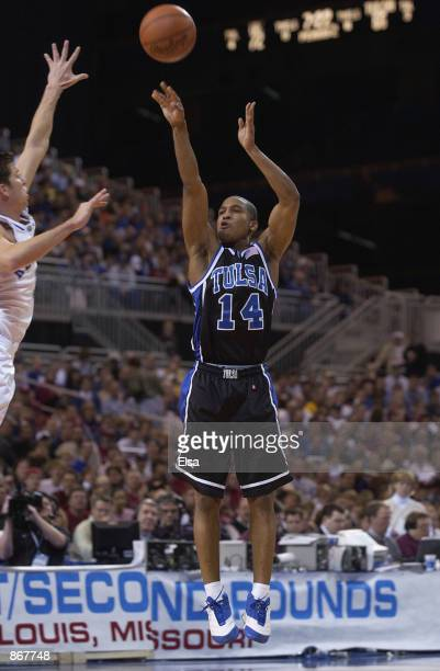 Guard Jason Parker of the Tulsa Golden Hurricanes takes a shot against the Kentucky Wildcats during the second round of the 2002 NCAA Division I...