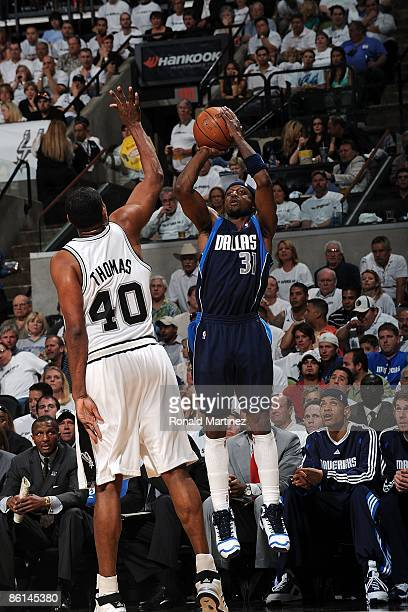 Guard Jason Terry of the Dallas Mavericks takes a shot against Kurt Thomas of the San Antonio Spurs in Game One of the Western Conference...