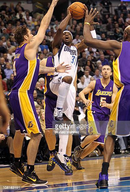 Guard Jason Terry of the Dallas Mavericks takes a shot against Luke Walton of the Los Angeles Lakers at American Airlines Center on January 19 2011...