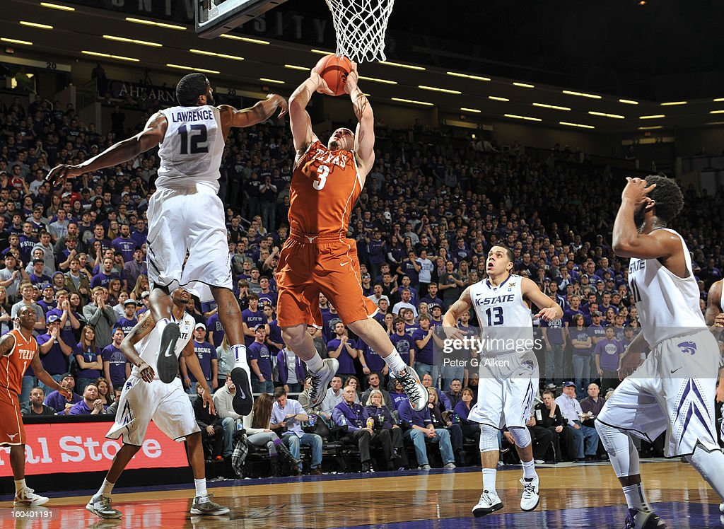 Guard Javan Felix #3 of the Texas Longhorns drives to the basket against guard Omari Lawrence #12 of the Kansas State Wildcats during the first half on January 30, 2013 at Bramlage Coliseum in Manhattan, Kansas.