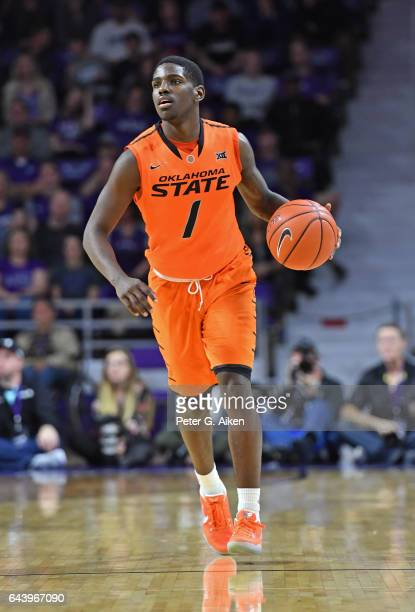 Guard Jawun Evans of the Oklahoma State Cowboys brings the ball up court against the Kansas State Wildcats during the first half on February 22 2017...