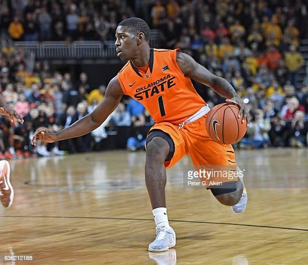 Guard Jawun Evans of the Oklahoma State Cowboys dribbles up court against the Wichita State Shockers during the first half on December 17 2016 at...