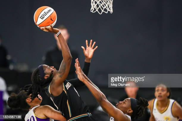 Guard Jazmine Jones of the New York Liberty shoots defended by guard Erica Wheeler of the Los Angeles Sparks at Los Angeles Convention Center on June...