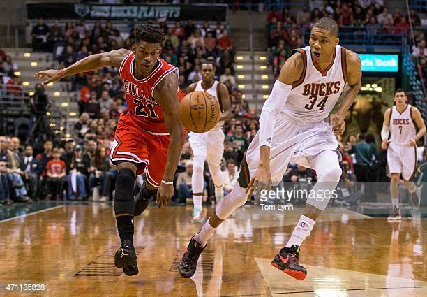 Guard Jimmy Butler of the Chicago Bulls tips the ball away from forward Giannis Antetokounmpo of the Milwaukee Bucks in the first quarter of game...