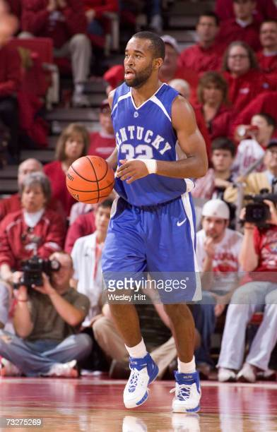 Guard Joe Crawford of the Kentucky Wildcats dribbles the ball down the court against the Arkansas Razorbacks at Bud Walton Arena on February 3, 2007...