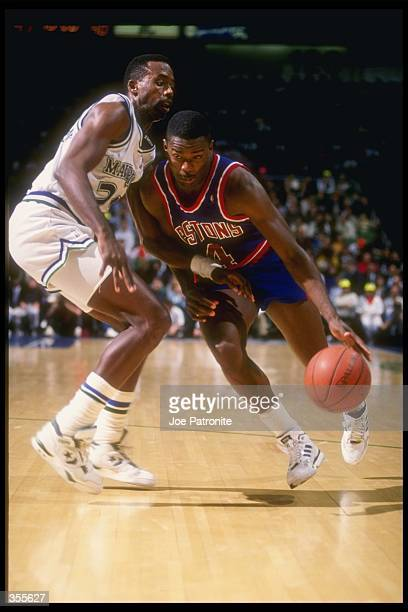 Guard Joe Dumars of the Detroit Pistons moves the ball during a game against the Dallas Mavericks at Reunion Arena in Dallas Texas Mandatory Credit...