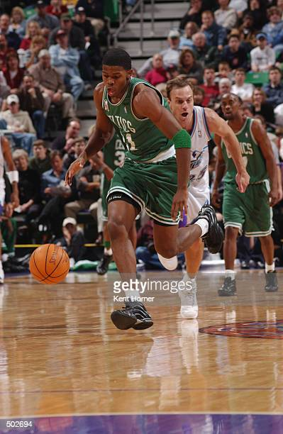 Guard Joe Johnson of the Boston Celtics dribbles the ball during the NBA game against the Utah Jazz at the Delta Center in Salt Lake City Utah on...