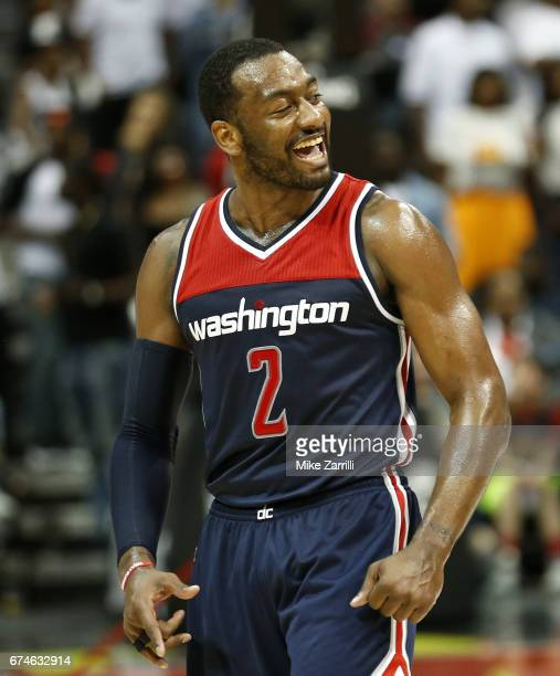 Guard John Wall of the Washington Wizards celebrates during Game Six of the Eastern Conference Quarterfinals against the Atlanta Hawks at Philips...